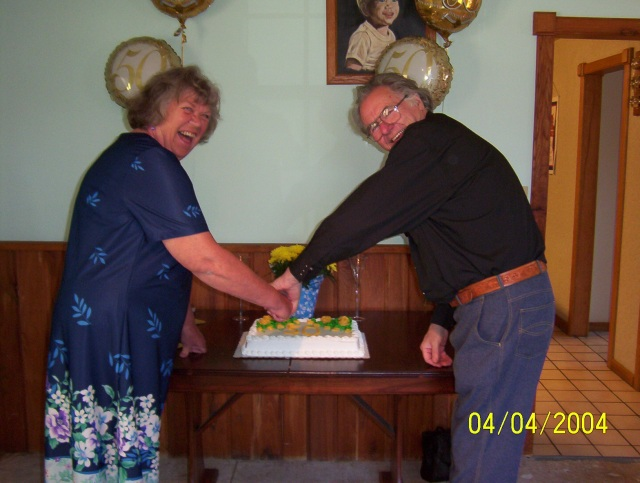 Cutting our cake on our 50th Anniversary